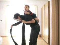 Strap carry and quite possibly the most bizarre babywearing video I have ever seen.