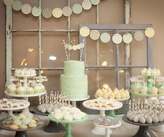 How sweet is the soft color palette for this dessert table?