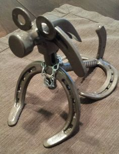 Really cool dog made out of horseshoes. Rustic western decor. How unique! Handcrafted