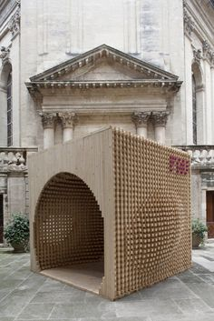 AtelierVecteur created a welcome pavilion for the festival to orient visitors and help them find all the pavilions in the maze of the city center. Constructed completely out of wood 'sticks,' the pavilion is formed by the intersection of a cube and what the designers describe as an 'ovoid.' The intention was to present viewers with a formal paradox, eliciting interest and inviting them to experience the interior of the pavilion. Most visitors, though, will be interested in the jarring…