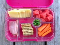 Yumbox container used Whole grain woven crackers Applegate ham Organic cheese slices Watermelon Carrots Frozen peas (defrosted by lunchtime)