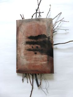 story, in between. altered book with twigs. Ines Seidel