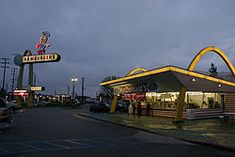 The McDonald's in Downey, California is almost unchanged in appearance since it opened in 1953.  http://www.downeyca.org/visitors/attractions/mcdonalds.asp