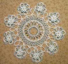Prettiest doily ever! (Intatters IdahoCanuk) this is the designer and the finished product of the Yes U Can doily II.
