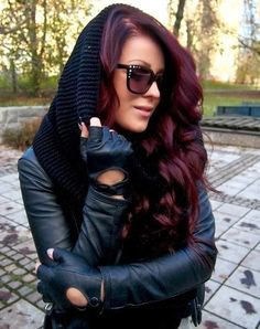 Dark burgundy hair color.