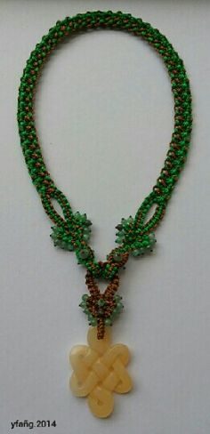 Very natural.. Brown and green macrame necklace with green aventurine and chinese lucky yellow jade pendant