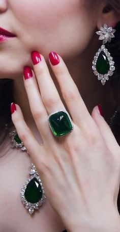 Emeralds & Diamonds 39cts - not all at once - it is better to wear only one statement piece.  Earrings and ring together would be fine.