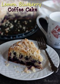 Lemon Blueberry Coffee Cake - Tender, moist lemon coffee cake loaded with blueberries crowned with a crunchy, sweet crumb topping and drizzle