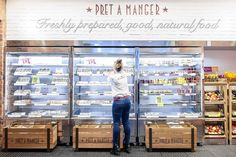 An employee restocks a refrigerated case at a Pret A Manger store in London. The...