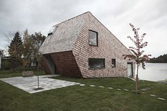 Cone House is located on the Stockholm Archipelago. By Swedish firm trigueiros architecture