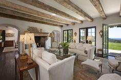 beautiful room with reclaimed wood beams