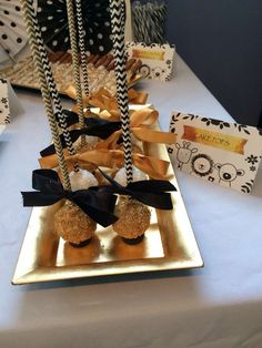 Glittery cake pops at a white, black and gold baby shower party! See more party planning ideas at CatchMyParty.com!