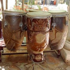 Beautiful Conga/Tumba hand drum set up... Unique, as the center drum has a djembe like base, probably to produce a distinctly different sound... a work of art...