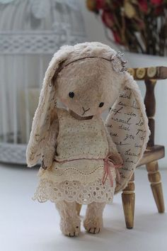 Bunny stuffie with word-print fabric inside the ears