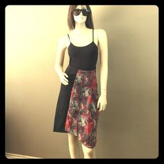 """Black, Red& Grey Parisian Asymmetrical Skirt Stunning asymmetrical skirt. Has side zipper with hook and eye closure. Sexy slit up the front. Front is also pleated. Solid black back. Label reads size 36. I would say fits U.S sizes XS-S best as the waist measures 13"""" flat and does not stretch. 97% cotton 3% spandex.  Ask about 15% off Bundle Deals  namaste Jackie Rose Paris Skirts Asymmetrical"""