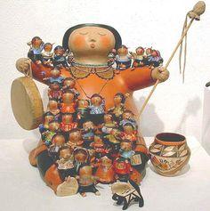 Storyteller on drum with children, gourd art by robert rivera