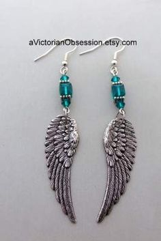 silver earrings Angel Wings chandelier earrings teal aqua by aVictorianObsession. Angel Earrings, Wing Earrings, Feather Earrings, Bead Earrings, Silver Earrings, Feather Jewelry, Wire Jewelry, Beaded Jewelry, Jewelery