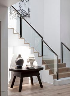 mobile in stairwell + simple bench table
