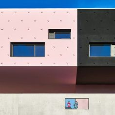 french architect dominique coulon has realized this pink and black school in montpellier as a series of stacked volumes with cantilevers providing sheltered areas below. via- architecture, design