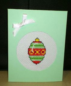 Bauble Christmas Card on mint green Christmas card   $2 each  Trifold card so stitching is covered.  Comes blank ready for your inscription.  Also comes with an envelope.  Facebook - Custom Cross Stitch Creations
