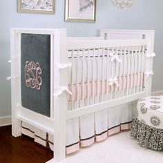 Baby room bedding inspiration: classic and elegant crib and bedding. I love the monogrammed crib panel at the end of the bed. #baby #nursery