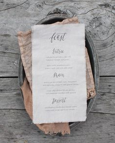 textural linen menu with calligraphy
