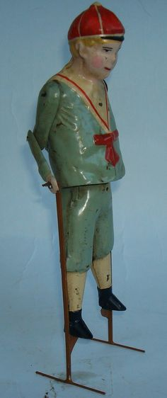 'Boy on stilts' wind-up tin toy. Schuco is my guess, 1030s Germany. I'd love to see one come staggering into the room.