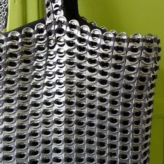 So cool... tote bag made of bottle can top thingies... I am so going to try to make this!!!