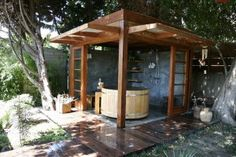 Japanese style bathhouse complete with outdoor shower. The sunny California weather is perfect for outdoor showers. And this one, complete with wooden Japanese inspired hot tub creates the perfect space.