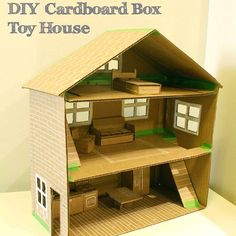 Make a cost-effective dollhouse for the kids out of a cardboard box.