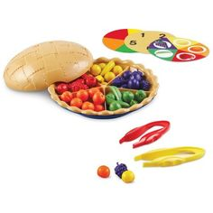 "Learning Resources Super Sorting Pie by Learning Resources. $24.51. Fruity pie teaches early number skills and attributes (colors and fruit shapes). Place the sorting cards into the bottom of the pan to provide visual cues that support student success. Top crust becomes a bowl to conveniently hold counters. Jumbo tweezers reinforce fine motor skills. Includes 60 counters (7 fruits in 5 different colors), durable plastic pie (8 3/4"" in diameter), removable divider, 3 doubl..."