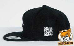 Yupoong / Flexfit Classic Snapback Cap black with a custom QR code embroidery on the side, about 3cm high. http://merch4you.net/flexfit-classic-snapback-caps-besticken/