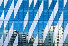 Saxo Bank - Reflections // Apartments reflected in the facade of Saxo Bank. Tuborg Harbour, Copenhagen, Denmark
