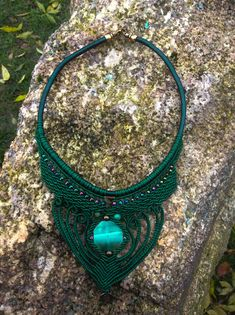 Handmade Macrame Necklace  Colour: Dark green Materials: -Waxed thread -Green flat octagonal stone -Iridescent glass beads -Bronze charm & beads -Knotted on leatherette chain -Bronze lobster clasp Length: 18(45.7 cm)  All our necklaces are designed to accent the neckline. They are