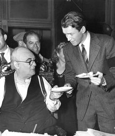 """Jimmy Stewart and Lionel Barrymore behind the scenes of """"It's a Wonderful Life"""", 1946"""
