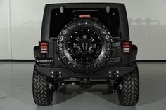 2014 Jeep Wrangler Unlimited with MBRP Front Bumper: Custom Rear Bumper and Tire Carrier