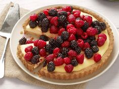 Cheesecake Tart With Berries - On Poinsettia Drive #dessert #berries #blueberry #cheesecake #razeberry Memorial Day Desserts, Köstliche Desserts, Dessert Recipes, Tart Recipes, Food Network Recipes, Food Processor Recipes, Kitchen Recipes, Cooking Recipes, Biscuits Graham