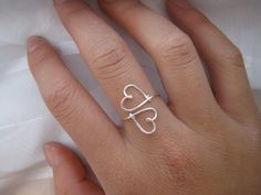 This is a wire ring that is in the shape of two hearts! It is made out of non-tarnish wire, sterling silver or 14K gold filled wire.