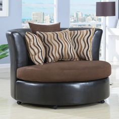 Round Cuddle Chair. We would have bought this chair to match our sectional but it wouldn't fit. This is my dream chair!!!!