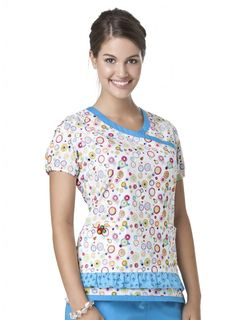 c9181914a63 Mary Engelbreit's Circle of Friends print scrub top features shirring  detail at the shoulder and sleeve