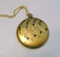 Antique Edwardian Wightman & Hough Locket Necklace, Antique Gold Filled Locket Necklace, New Mom Gift  A beautiful antique Edwardian locket is the focus of this necklace. The locket has a gorgeous Arts and Craft etched design and is accented with sparkling multi-color paste stones. It is suspended from a 14k gold filled chain that I made and measures 17 1/2 long with a 1 1/2 extender chain. Absolutely beautiful and one of a kind!!  - Age: Edwardian, Early 1900s  - Makers Mark: W...