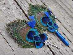Peacock Feather Boutonniere - definitely won't pay $85 dollars, but good inspiration