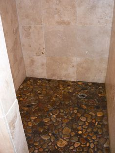 Pebble shower floor with dark grouting