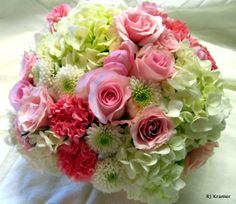 Pink roses, hydrangea, carnations, and mums