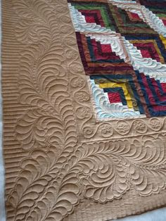 Look at the quilting on the log cabin quilt!