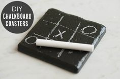 DIY chalkboard coasters. Would be cute as favors. You could tie it up with twine and a thank you tag. Or write on the top coaster a thank you note.