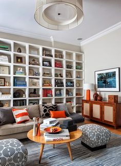 Gorgeous bookcase styling, pillows, and table scape