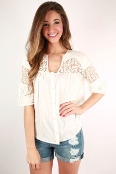 Super soft fabric meets delicate lace in this lovely little top!