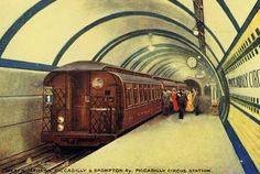 A train of the original Piccadilly line stock enters Piccadilly Circus station shortly after opening in 1906