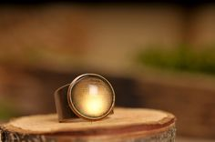 Moon glow ring, adjustable ring, statement ring, shiny ring ring, antique brass ring, glass ring, cocktail ring, moon ring, moon jewelry by SomeMagic on Etsy https://www.etsy.com/listing/206001481/moon-glow-ring-adjustable-ring-statement